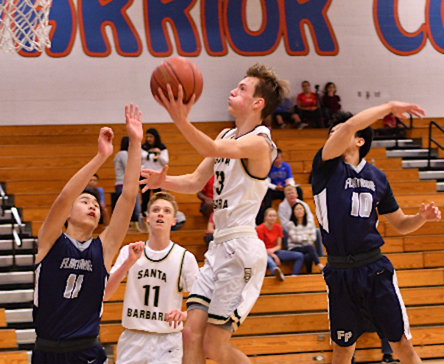 Morgan Peus of Santa Barbara drives to the basket for two of his 26 points against Flintridge Prep.