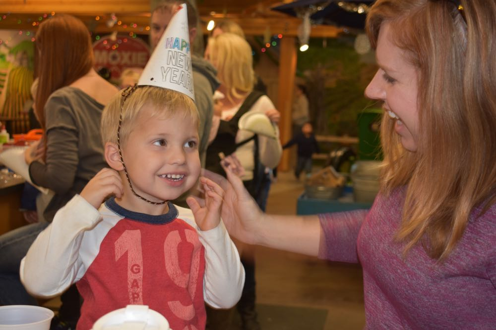 Kristin Patterson smiles as son Oliver Patterson, 2, of Orcutt sports his new party hat during the Noon Year's Eve celebration at the Santa Maria Valley Discovery Museum.