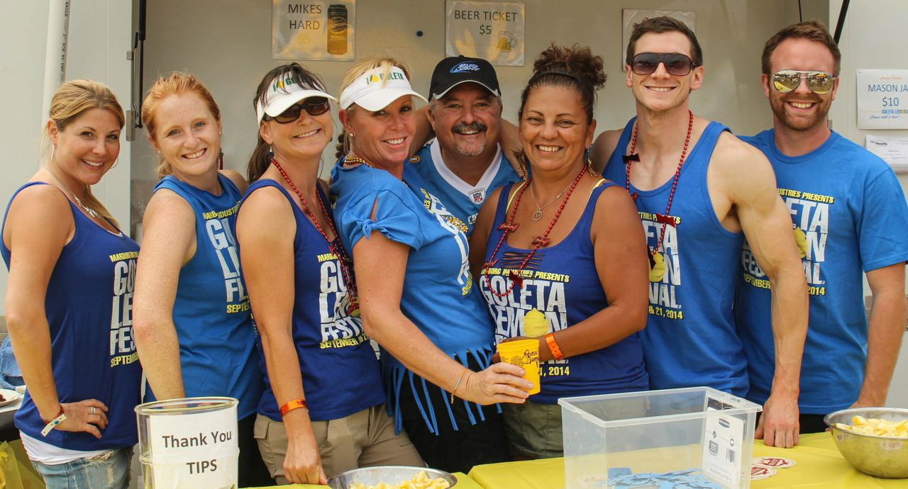 The lemon-beer booth is always a popular — and fun-loving — stop at the annual California Lemon Festival in Goleta. Among those serving the suds Sunday were, from left, Dawn sproul, Laura Hunt, Cary Harrison, Michele Talkington, Drew Wakefield, Maria Jimenez, Will Nelson and Dave Hinterschield.