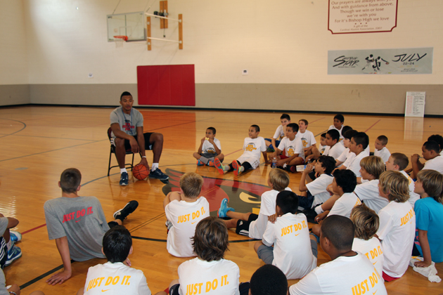 Camp participants gather around Orlando Johnson for an interactive lecture.