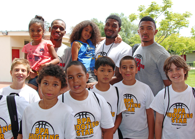 Shooting Star Youth Basketball Camp co-founders and NBA players Julyan Stone, James Nunnally and Orlando Johnson with camp participants at a luncheon concluding a three-day camp through the United Boys & Girls Clubs of Santa Barbara County.