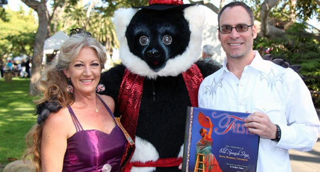 Old Spanish Days director Wendy Figueiredo and Santa Barbara Zoo member A. Arthur Fisher, author of 'Fiesta, The Celebration of Old Spanish Days,' are joined by a furry friend at Thursday evening's Celebracion de Los Dignatarios at the zoo. (Melissa Walker / Noozhawk photo)