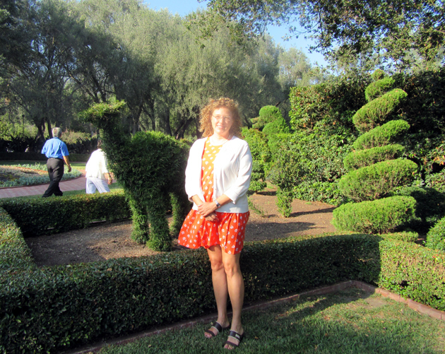 Guest and poet Tiffany Krupa enjoys the topiary garden.