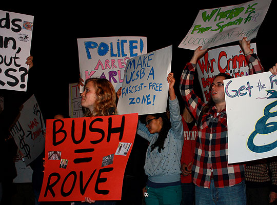 Protesters await Karl Rove's arrival for a speech at UCSB's Campbell Hall on Thursday night. As word spread that the Republican political strategist would be arriving at the rear entrance, part of the crowd splintered off to try to intercept him.