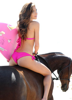 Happy Endingz Eco Swimwear model Anna Elbek sports a pink passion ruffled bikini made from 100 percent recycled nylon.