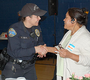 Santa Barbara police Officer Kasi Beutel introduces herself to a Westside resident during Saturday's community summit at the Westside Boys & Girls Club.