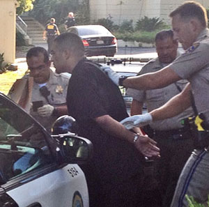 Not so fast. An alleged gang member is handcuffed after his capture in Montecito following a high-speed chase that started in Buellton. (John Palminteri photo / KEYT News)