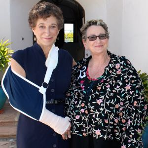 District Attorney Joyce Dudley, with Hadassah Santa Barbara president Deborah Schwartz, was sporting a new sling Sunday, hours after she may have fractured her arm when she fell during the State Street Mile race. (Joshua Molina / Noozhawk photo)