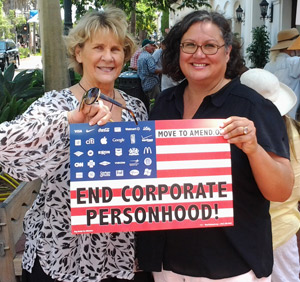Rally organizer Lois Hamilton, left, with Santa Barbara City Councilwoman Cathy Murillo, says she wants 'the people of this country to choose their representatives, not corporations.' (Patrick Kulp / Noozhawk photo)