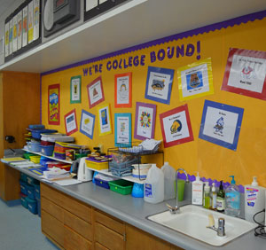 To help plant the seeds for a future that includes college, each El Camino School classroom 'adopts' a university. The students adorn the walls with pennants, chant cheers and write to students at the college. (Giana Magnoli / Noozhawk photo)