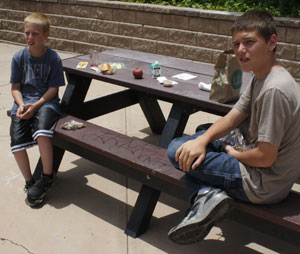 Brothers Ian Baker, right, and Brendan Seidel learned about compost, germination and food literacy during Friday's Picnic in the Park. And they chowed down on a healthy lunch. (Linda Sturesson / Noozhawk photo)