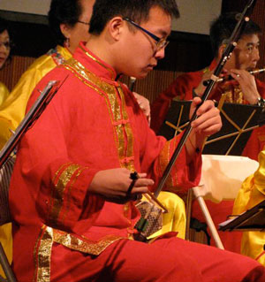 Musicians play Chinese instruments at the year of the Yang Water Dragon celebration.