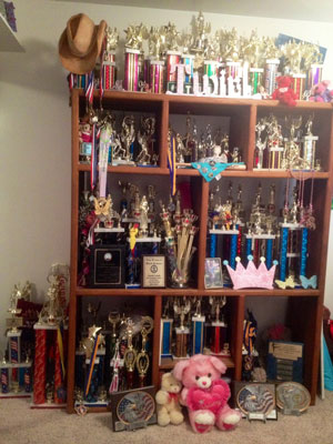 Nationally ranked baton-twirler Kaycie Landis has a bookcase of awards, ribbons and trophies to show for her hard work. (Landis family photo)