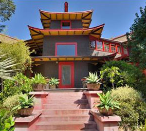 The 1902 Pagoda House features tapering stories, redwood paneled walls and rooflines with lifted eaves.
