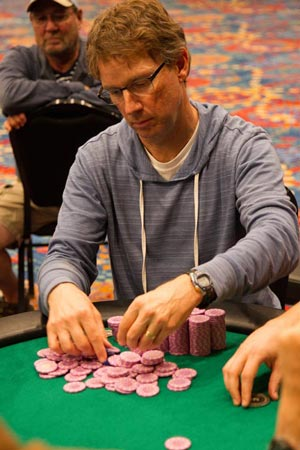 Rob Raede of Santa Barbara stacks his chips at the final table. (Gary McDuffie photo / Chumash Casino Resort)