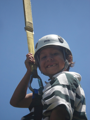 Camp Whittier's popular ropes courses bring out the smiles, whether participants are hanging around five feet off the ground or 40. (Camp Whittier photo)