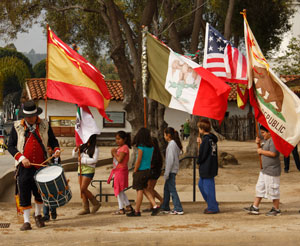 Russell Ruiz leads his charges in showing the flags. (Santa Barbara Trust for Historic Preservation photo)