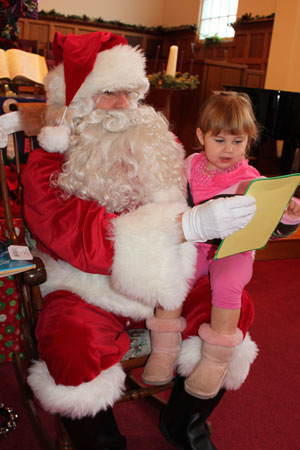 For more than 20 years, Kenny Slaught has ensured that Santa Claus visits the Storyteller Children's Center every Christmas. (Storyteller Children's Center photo)