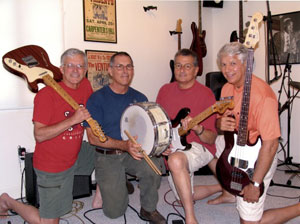 The Tridents reprise an early pose in a 2005 reunion.