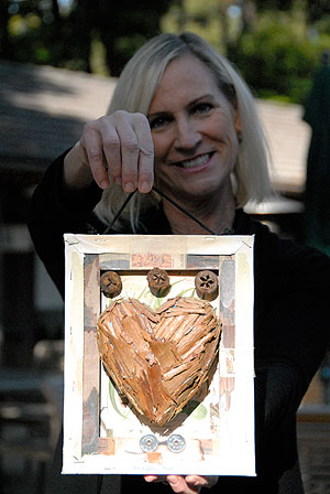 The annual Festival of Hearts is Friendship Center's main fundraiser. Executive director Heidi Holley shows off a heart created by local artist Steven Gilbar, which will be auctioned at the Feb. 12 fundraiser at Fess Parker's DoubleTree Resort.