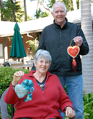 Friendship Center members proudly display two hearts that will be auctioned at the 12th Annual Festival of Hearts fundraiser.