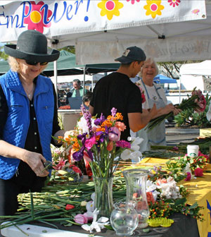 It's not uncommon for Flower Empower volunteers to expertly assemble as many as 100 bouquets every Saturday at the Santa Barbara Farmers Market.