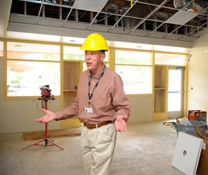 SBUSD construction project manager Carl Mayrose describes the faculty dining area adjacent to the revamped kitchen at Santa Barbara High. (Lara Cooper / Noozhawk photo)