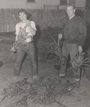 Dale Howell and Jim Terres show off the bounty from one of their lobster fishing excursions.