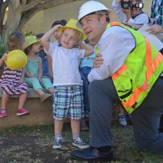 Santa Barbara Cottage Hospital demolition project manager Nick Henderson and his son, Owen, check out the crane tearing down the building's central wing. Owen and his preschool classmates were on a field trip to watch the demolition Friday. (Giana Magnoli / Noozhawk photo)