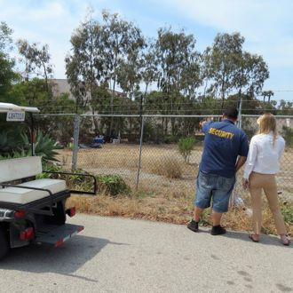 Several homeless encampments are regular stops on the route of Casa Esperanza security guard Eddie Parreguire, left, who points the areas out to development director Kathleen Wilson. A new golf cart now aids Parreguire on his rounds so he can cover more ground faster. (Gina Potthoff / Noozhawk photo)