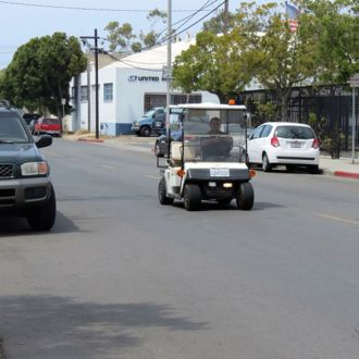 Casa Esperanza security guard Eddie Parreguire can cover more ground with help from a golf cart purchased by the Milpas Community Association to patrol around Lower Eastside neighborhoods. (Gina Potthoff / Noozhawk photo)