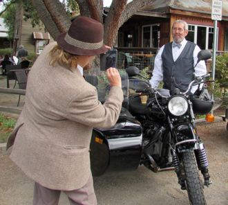 Distinguished gentlelady Eve Byrd takes a photo of a dapper Mike Byrd. The Arroyo Grande couple participated in the Distinguished Gentleman's Ride on Sunday. (Janene Scully / Noozhawk photo)