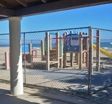 Fenced off after being declared unsafe, the playground at the Cabrillo Pavilion Arts Center will soon undergo renovations of its own. (Giana Magnoli / Noozhawk photo)