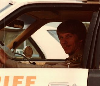 Santa Barbara County Acting Undersheriff Don Patterson in a patrol car not long after he started at the Sheriff's Department in 1979. (Patterson family photo)