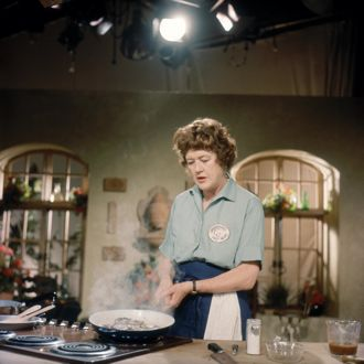 Celebrity chef Julia Child cooks up a meal for a episode of her long-running television show. (Schlesinger Library file photo / Radcliffe Institute at Harvard University)