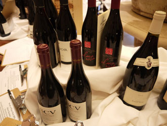 The silent auction during Friday's Grand Tasting included library and large format wines, including some from Alma Rosa Winery, rear. (Laurie Jervis / Noozhawk photo)