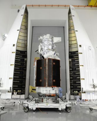 The WorldView-3 commercial imaging satellite is pictured sitting between the two halves of the Atlas 5 rocket payload fairing. The satellite is scheduled to launch Wednesday from Space Launch Complex-3 at Vandenberg Air Force Base. (Ball Aerospace & Technologies Corp. image)