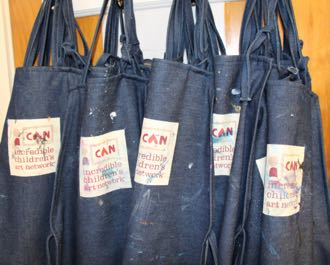 Student aprons, lovingly used and spattered with paint, hang on their hooks, awaiting the next art class at Santa Barbara Community Academy. (Melissa Walker / Noozhawk photo)