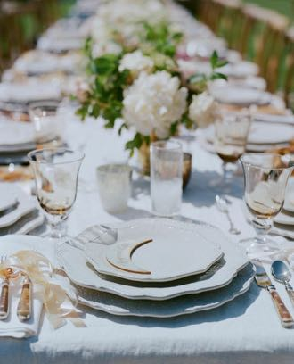 Event planner Merryl Brown suggests weaving the mood and the theme of the party into the table décor, including the lighting, flowers and table linens.  (Elizabeth Messina photo)