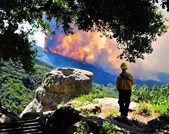 During last year's Jesusita Fire, Painted Cave volunteer firefighters kept a wary eye on rapidly approaching flames.