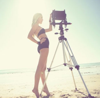 Maika Monroe modeling on a fashion photo shoot at her favorite place: the beach.