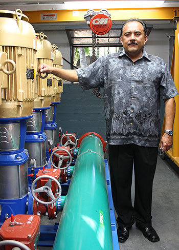 La Cumbre Mutual Water Co. general manager Mike Alvarado shows off the unitilty's new groundwater pumps. The pumps' gold color denotes
