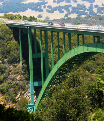In preparation for the installation of a suicide-prevention barrier along the sides of Cold Spring Canyon Bridge, construction crews are drilling holes in the concrete surface.