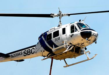 Santa Barbara County Fire Helicopter 308 was one of the department's aircraft that was consolidated under the Sheriff's Department earlier this year. A group calling itself 'Concerned Professional Firefighters' has alleged that maintenance — and public safety — has suffered since the merger. (Lara Cooper / Noozhawk file photo)