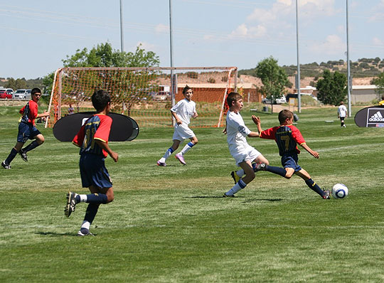 Tony Andoyan races downfield, trailed by, from left, Peter Bermant and Benji Garcia, at the 2010 Far West Regional Championship Series in Albuquerque.