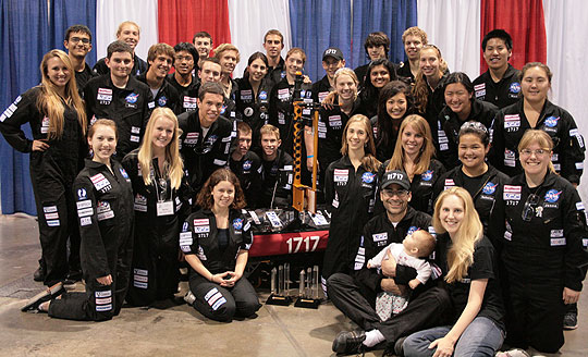 The Dos Pueblos Engineering Academy's Robotics Team 1717 gathers around the best-designed robot at the 2010 FIRST Robotics World Championship in Atlanta.
