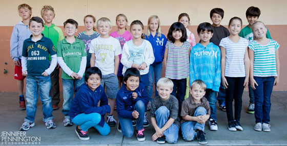 Monroe School's twins include, back row from left, fourth-graders Kai and Tavi, fourth-graders Bella and Roxie, fourth-graders Georgia and Fionna, and fifth-graders Sebastian and Emmanuel. Middle row from left are first-graders Tyler and Ryan, second-graders Quinn and Nora, third-graders Morgan and Liam, and fourth-graders Angelica and Isabella. Front row from left are third-graders Arlene and Arlette, and kindergarteners Mason and Noah. Not pictured are second-graders Christian and Javier. (Jennifer Pennington photo / www.jpphoto.com)