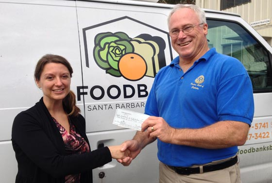 Melissa Howard, community leadership coordinator at the Foodbank of Santa Barbara County, accepts a $1,000 check from Rotary Club of Goleta treasurer Brooke Armstrong. (Rotary Club of Goleta photo)