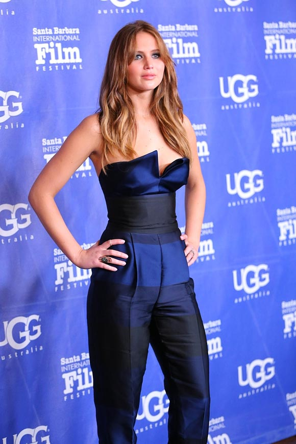 For her Saturday night appearance, actress Jennifer Lawrence was wearing a striking navy jumpsuit from Stella McCartney.