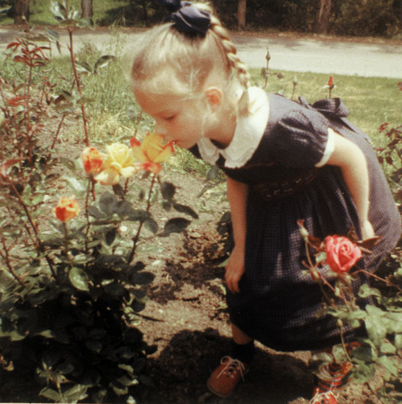 A young Dani Hahn smelling 'Sutter's Gold' in her grandmother's garden.